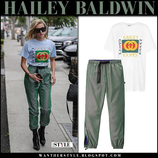 Hailey Baldwin in white gucci logo tee and green pants opening ceremony model street fashion march 12