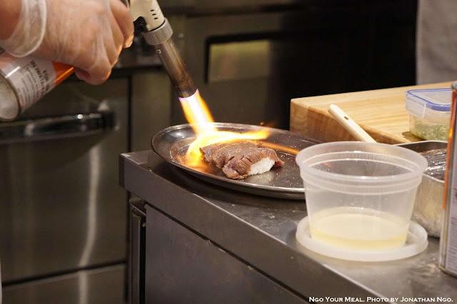 Searing the Washu Beef Sushi at Shuraku in New York City