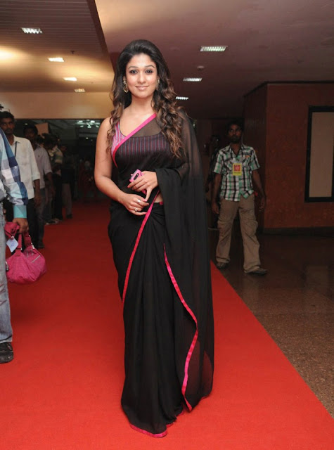 Nayanthara wearing Black colour Georgette saree paired with sleeveless brocade blouse