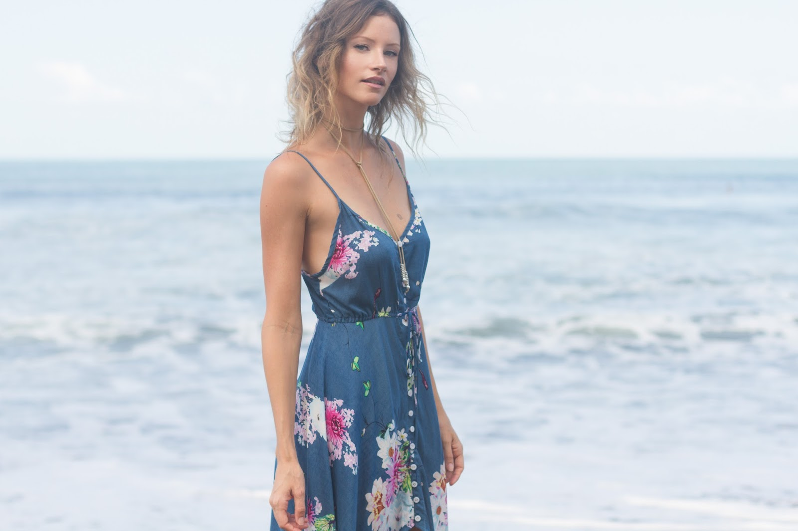 fashion blogger and designer Alison Hutchinson, iswearing a KAYVALYA Jade Dress in Blue Floral