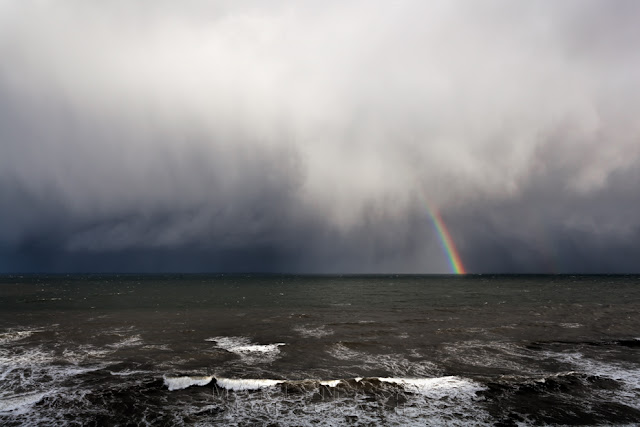 Marsden coastline and The Leas view of a storm cloud and rainbow