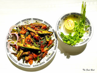Crispy okra, delicately tempered with the panch phoran, the aromatic Bengali spice mix combined with garden-fresh tomatoes!