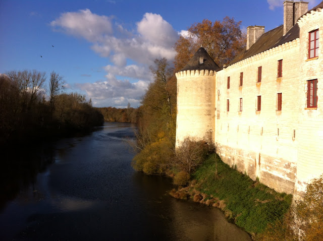 Chateau de La Guerche on the river Creuse with the sun giving it a yellow glow