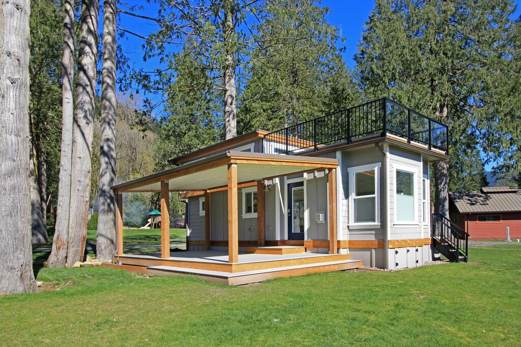 Tiny house town the bellevue at wildwood lakefront cottage for Luxury cottage homes