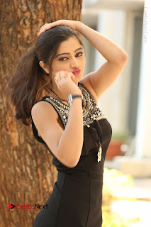 Actress Poojitha Pallavi Naidu Stills in Black Short Dress at Inkenti Nuvve Cheppu Movie Platinum Disc Function  0071.JPG