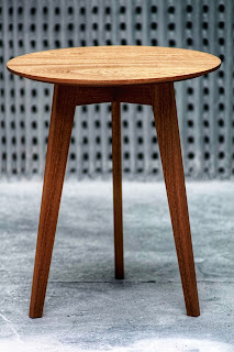An image of a small three legged table