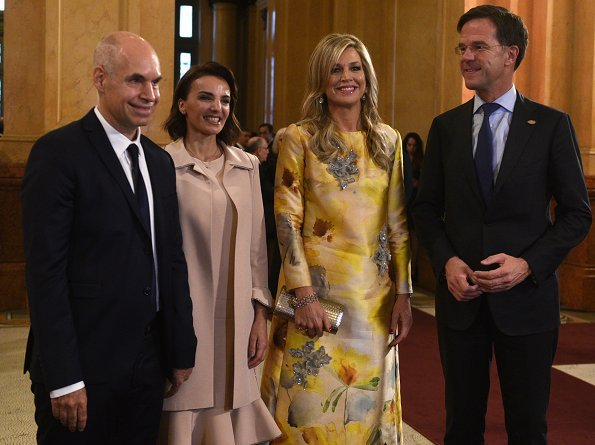 Queen Maxima wore Oscar De La Renta cold shoulder ruffled wool midi dress and Natan Embroidered yellow dress from Spring Summer 2018 collection