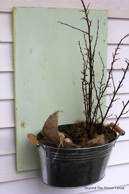an old cupboard door and metal tin makes a great planter