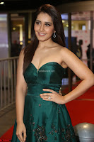 Raashi Khanna in Dark Green Sleeveless Strapless Deep neck Gown at 64th Jio Filmfare Awards South ~  Exclusive 130.JPG