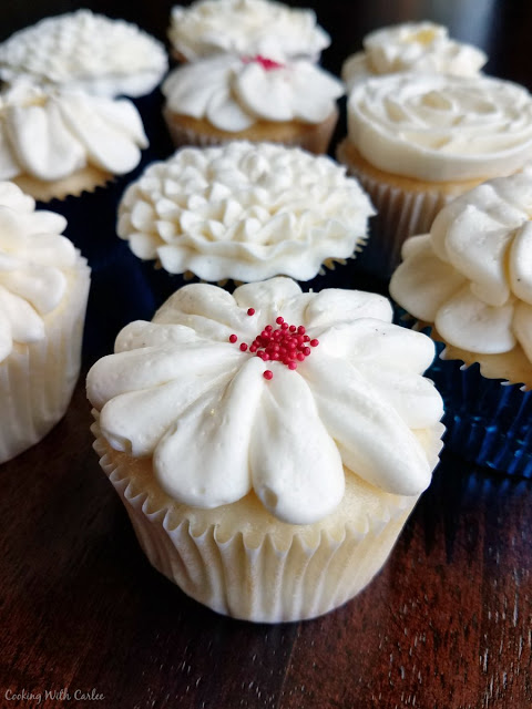 close up of frosted semi-homemade white cupcakes