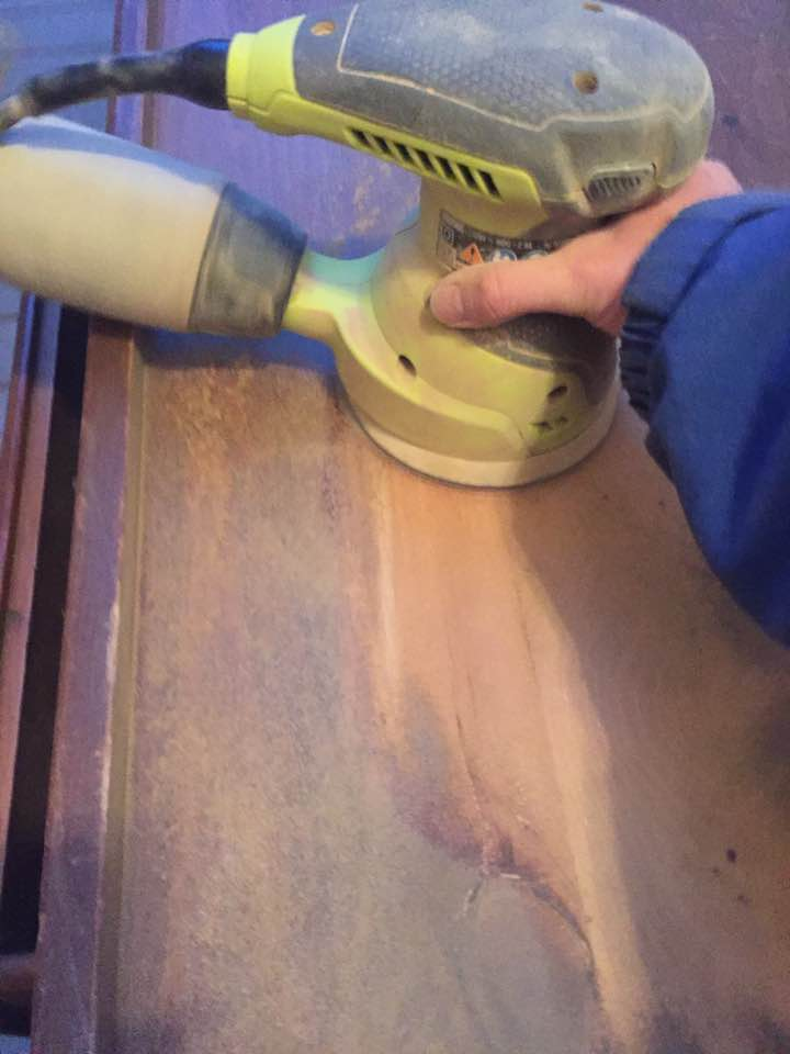 An orbital sander will quickly remove the damaged finish