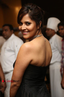 Telugu Anchor Actress Anasuya Bharadwa Stills in Strap Less Black Long Dress at Winner Pre Release Function  0035.jpg