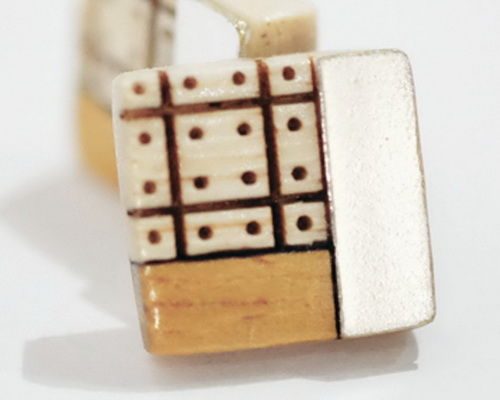 Tinuku.com Alive Jewelry displays wooden ear studs arrangement of small pieces into artistic fashion