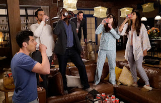 "The gang takes a shot in their loft to kick off a game of ""True American."""