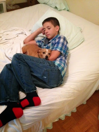 Boy and his dog...both tired.