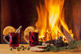 2 cups German Gluhwein in front of a fireplace - 2 cups German Gluehwein in front of a fireplace