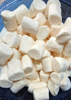 marshmallows ready to be microwaved