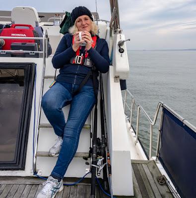 Photo of me enjoying a mug of tea on Ravensdale's aft deck