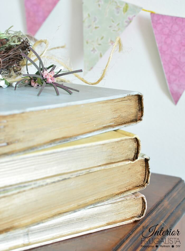 These pretty pastel painted hardcover book stacks with French Country style are an easy budget-friendly Spring decorating idea by recycling old books.