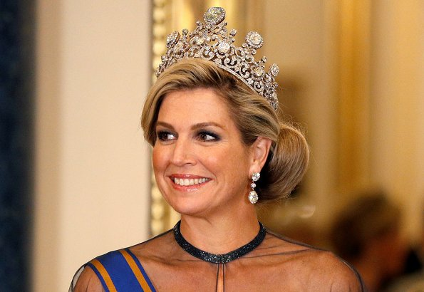 Kate Middleton's wearing the Lovers Knot Tiara, Diana's Collingwood earrings and blue McQueen gown. Maxima' Jan Taminiau gown and pearl tiara