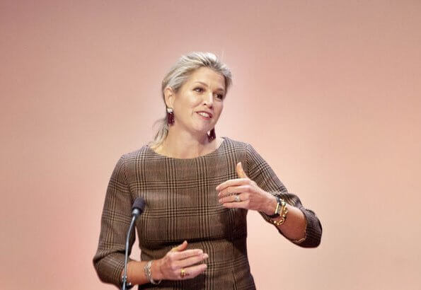 Queen Maxima's outfit is by Belgian fashion house Natan. Queen Maxima wore Natan jacket and Natan asymmetric skirts