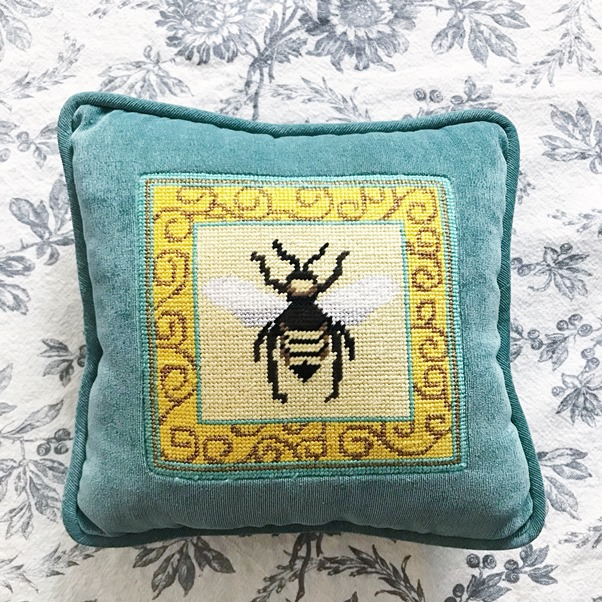 Yellow and blue bumble bee needlepoint pillow