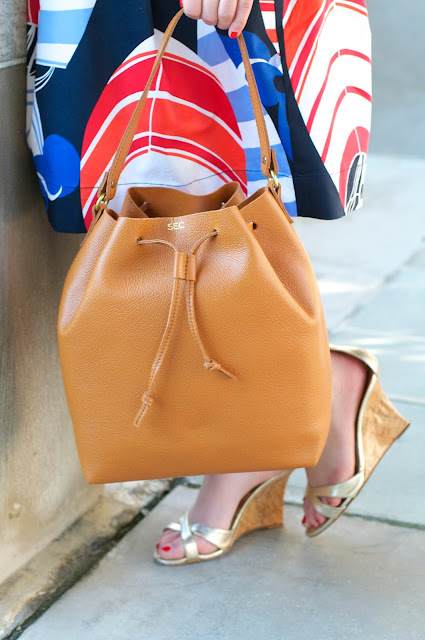 brown leather monogrammed bucket bag from mark and graham