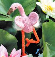 http://translate.google.es/translate?hl=es&sl=ru&tl=es&u=http%3A%2F%2Fwww.7ya.ru%2Farticle%2FAmigurumi-Vyazanye-igrushki-svoimi-rukami-Panda-i-flamingo%2F