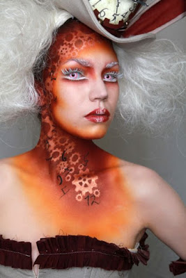 Steampunk special fx makeup uses a stencil to airbrush colorful makeup over the outline of metal gears