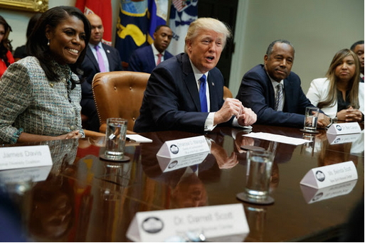 Among President Trump's closest African-American associates are, from left, Omarosa Manigault-Newman, a White House aide, Ben Carson, the secretary of housing and urban development, and Lynne Patton, head of the Department of Housing and Urban Development's New York and New Jersey office.