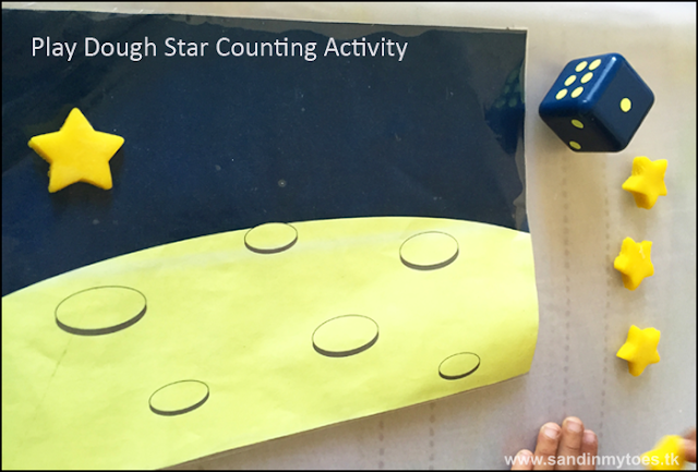 Play dough counting activity using a dice - fun for toddlers and preschoolers.