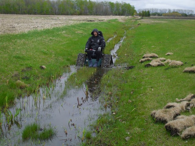 Tank Chair Wheelchair The Eames All About Machines Conquers Streams Mud Snow Sand And Gravel Allowing You To Get Back Nature Using Rubber Tracks High Torque Electric Motors