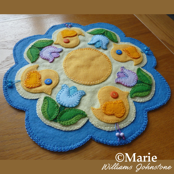 Bird chick and tulip flowers Spring candle mats penny rug design made with wool felt and simple embroidery stitches handmade