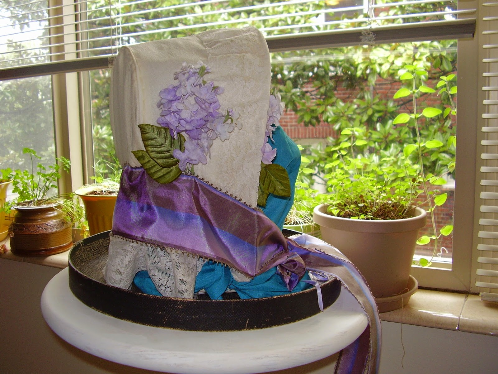White crape bonnet with lilacs, lace, and vintage ribbon.