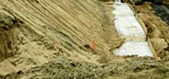 Berm to avoid base failure due to weight of soil