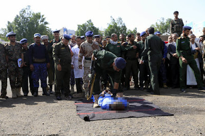 Soldiers crowded around the men, ordering them to lie down on the ground before shooting them (Image: EPA)
