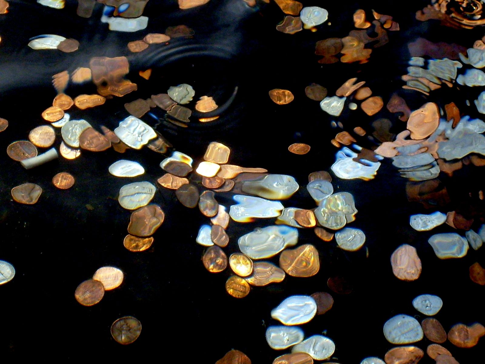 Throwing Coins Into A River