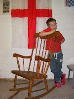 boy in red slippers and england flag