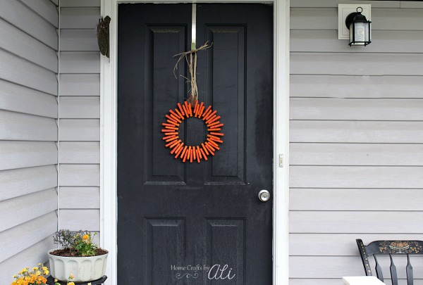 pumpkin wreath hanging on door front porch display