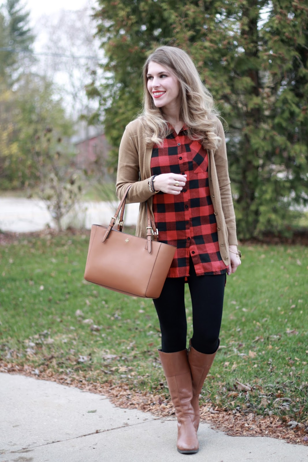 buffalo plaid top, beige boyfriend cardigan, black leggings, cognac riding boots, Tory Burch tote