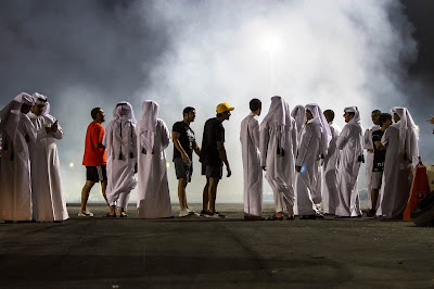 A crowd of Qatari youths gathers for freestyle drifting