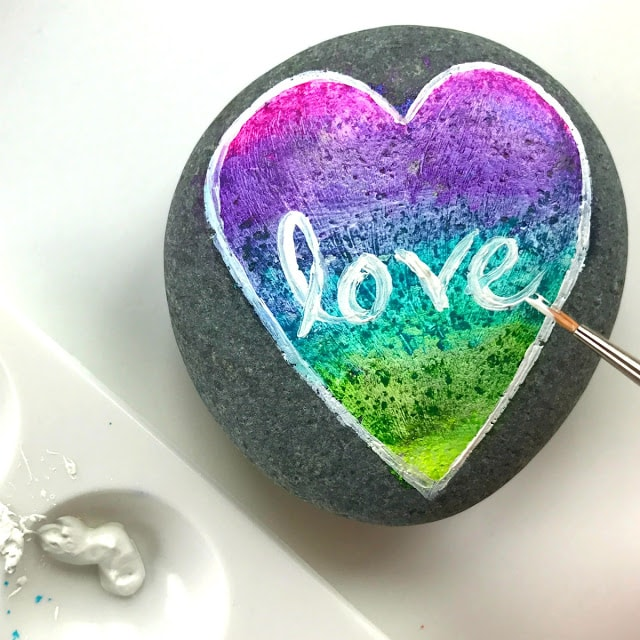 rock painting ideas: how to make a rainbow ombre heart rock with love on it from color made happy
