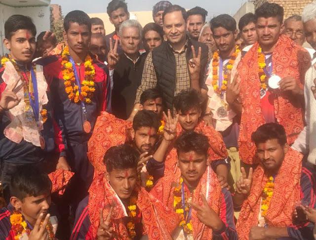 BJP leader Sohanpal Singh welcomes silver medal winners to Kabulpur village