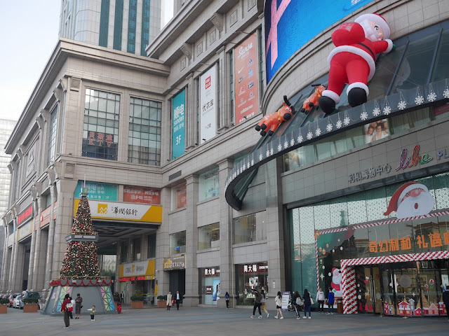 Christmas tree and giant reindeers and Santa Claus at Lihe Plaza in Zhongshan