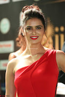 Meenakshi Dixit in Red One Shoulder Red Zipped up gown at IIFA Utsavam Award 57.JPG