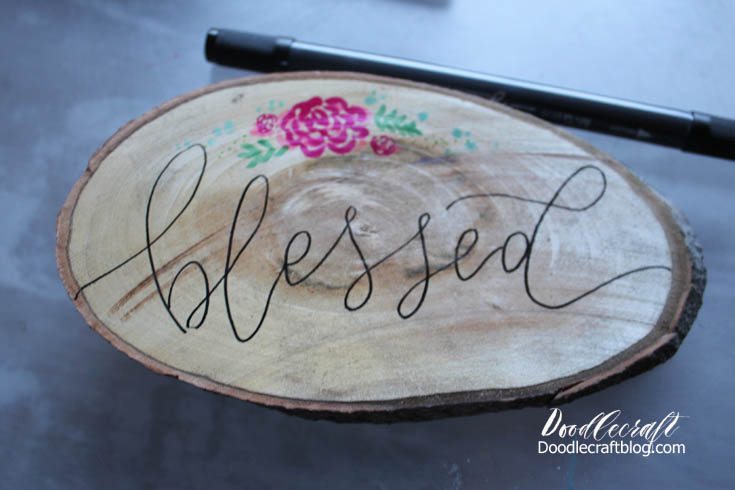 Doodlecraft faux calligraphy on wood slice