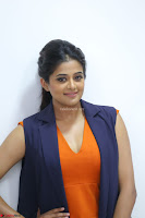 Priyamani in Beautiful Short Deep neck Orange Dress ~  Exclusive 07.JPG