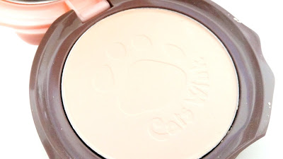 Cat paw and pact's name are pressed into the powder pact.