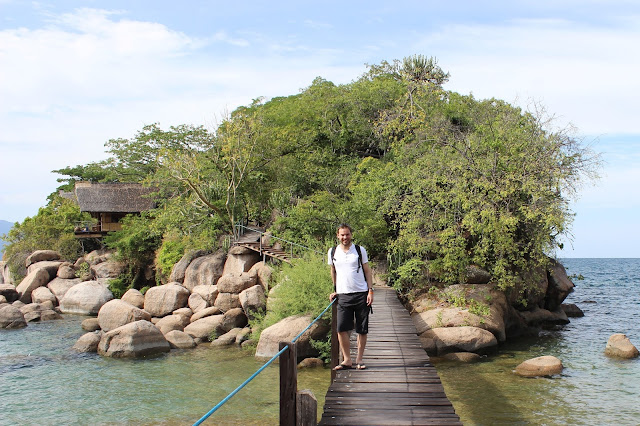 Simon Heyes standing on the bridge to the chalets - Mumbo Island