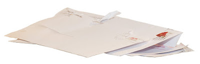 Several envelopes of opened mail.